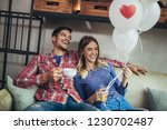 happy couple have fun in cafe... | Shutterstock . vector #1230702487
