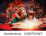 mother and her son are reading... | Shutterstock . vector #1230751567