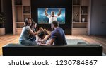 a family is watching a soccer... | Shutterstock . vector #1230784867