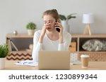 upset girl working on computer... | Shutterstock . vector #1230899344