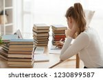 focused girl writing in... | Shutterstock . vector #1230899587