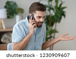 angry man talk on smartphone... | Shutterstock . vector #1230909607
