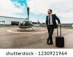 calm businessman in dark suit... | Shutterstock . vector #1230921964