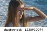 child playing on beach in... | Shutterstock . vector #1230930094