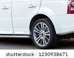 white suv car close up side... | Shutterstock . vector #1230938671