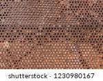 perforated and rusty metal ... | Shutterstock . vector #1230980167