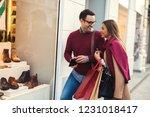 beautiful young couple enjoying ... | Shutterstock . vector #1231018417