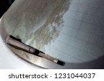 dirty car window wiper closeup. | Shutterstock . vector #1231044037