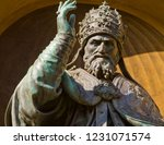 An Old Sculpture Of Pope...