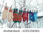 knitted mittens on natural... | Shutterstock . vector #1231156561
