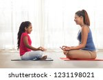 mother and daughter sitting... | Shutterstock . vector #1231198021
