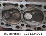 disassembled the cylinder head... | Shutterstock . vector #1231234021