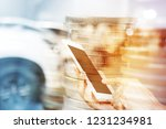hand with mobile phone and... | Shutterstock . vector #1231234981
