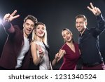 group of happy stylish young... | Shutterstock . vector #1231340524