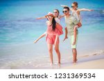young family on beach vacation... | Shutterstock . vector #1231369534