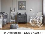 grey pouf on white carpet... | Shutterstock . vector #1231371064