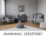 toy on grey pouf in the middle... | Shutterstock . vector #1231371067