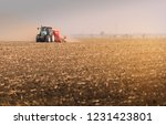 tractors plowing stubble fields | Shutterstock . vector #1231423801