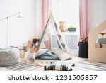 smiling kid on the floor and... | Shutterstock . vector #1231505857