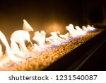 fire burning in a brazier on... | Shutterstock . vector #1231540087