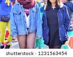 girls walk in the street at a... | Shutterstock . vector #1231563454