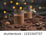 hot chocolate with cinnamon... | Shutterstock . vector #1231565737