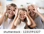 happy kid granddaughter  mother ... | Shutterstock . vector #1231591327