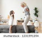 cute little girl having fun... | Shutterstock . vector #1231591354