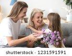 happy grandma embracing little... | Shutterstock . vector #1231591591