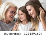 smiling loving three generation ... | Shutterstock . vector #1231591624
