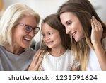 smiling loving three generation ... | Shutterstock . vector #1231591624