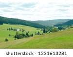 view on the fields and hills ...   Shutterstock . vector #1231613281