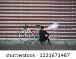Young Man Cyclist Sitting With...