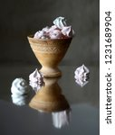 ceramic cup with cakes on the... | Shutterstock . vector #1231689904