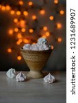 ceramic cup with cakes on the... | Shutterstock . vector #1231689907