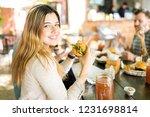 confident blond woman smiling... | Shutterstock . vector #1231698814