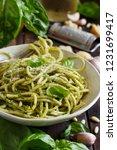 spaghetti pasta with pesto... | Shutterstock . vector #1231699417
