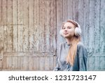 cute girl listening to music in ... | Shutterstock . vector #1231723147
