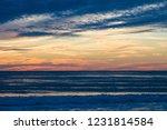 orange unset sky over gulf of... | Shutterstock . vector #1231814584