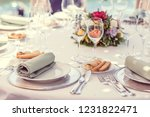 laid table with glasses and... | Shutterstock . vector #1231822471