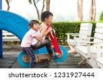 happy funny two little children ... | Shutterstock . vector #1231927444