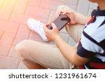child sitting outside school...   Shutterstock . vector #1231961674