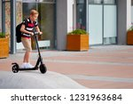 school boy in riding with his... | Shutterstock . vector #1231963684