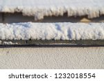 snow on the fence in winter as... | Shutterstock . vector #1232018554