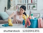 asian housewife wearing gloves... | Shutterstock . vector #1232041351