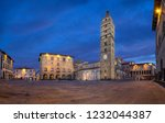 Pistoia, Italy. Panorama of Piazza del Duomo square with old Town Hall and Cathedral of San Zeno at dusk with HDR-effect