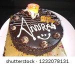 Small photo of a chocolate cake- Happy birthday Anurag