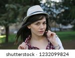 portrait of a woman with hat. | Shutterstock . vector #1232099824