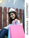 woman with shopping bags. | Shutterstock . vector #1232099827