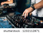 hands of the dj on the... | Shutterstock . vector #1232112871